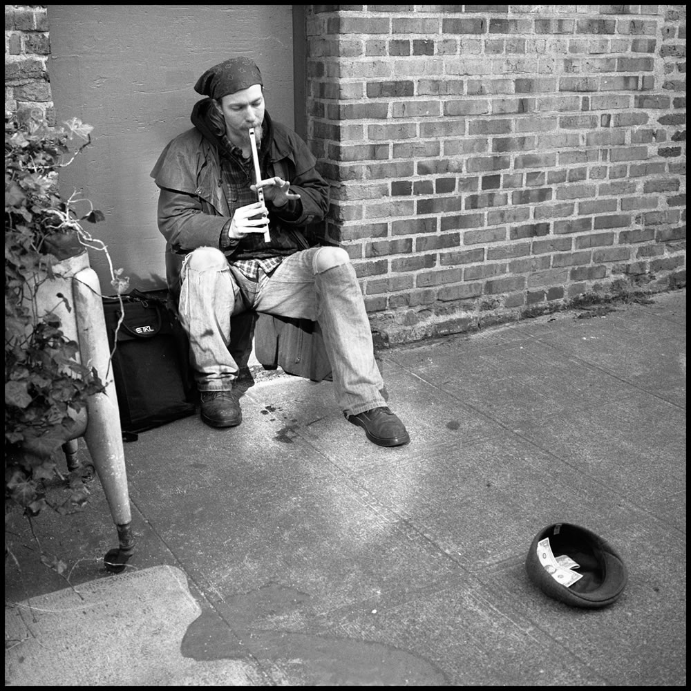 """Iford HP5, Rolleiflex TLR, """"The Cap Charmer"""" from """"A Little Street Music"""""""