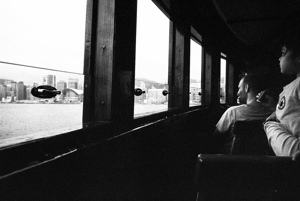 Looking out - Shot on Kodak EASTMAN DOUBLE-X 5222 at EI 800. Black and white film in 35mm format. Push processed 1+2/3 stops