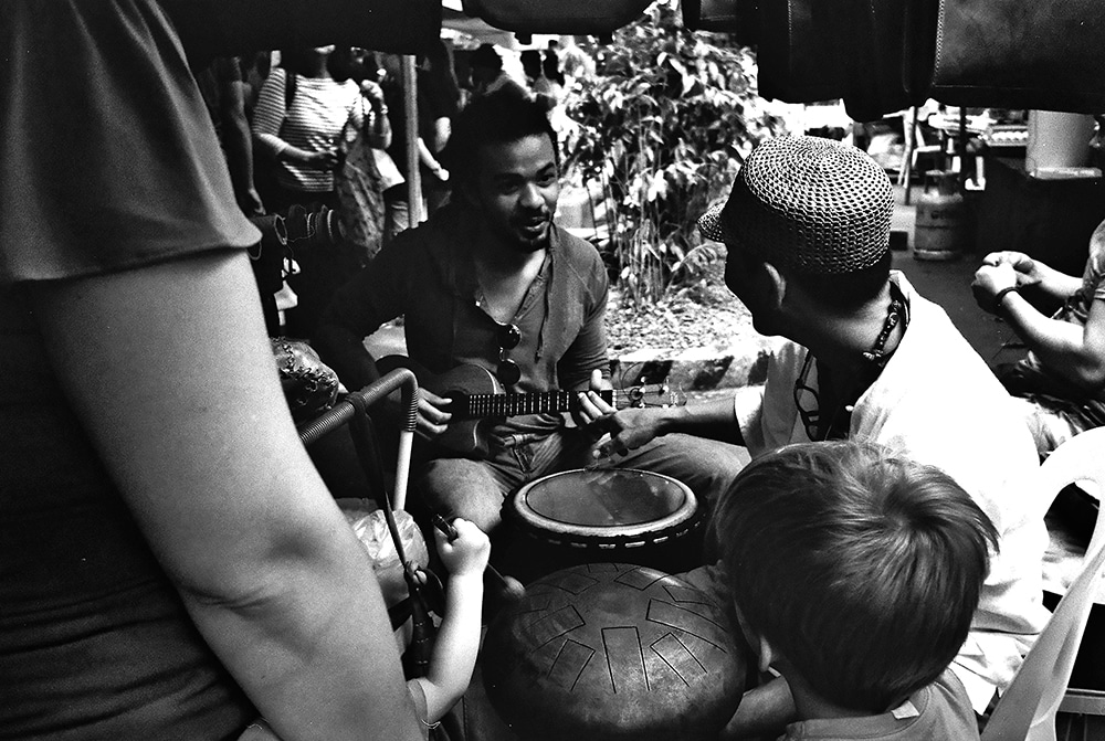Sunday Market, Olympus XA, JCH Streetpan - This was from my first roll of JCH Streetpan. I love this shot as it shows a medley of cultures. Music always brings people together.