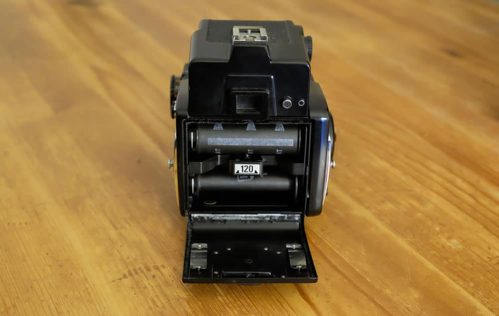 Mamiya 645 1000S - Loading film step 6 - Reinstall the loaded film holder, making sure it clicks into place.