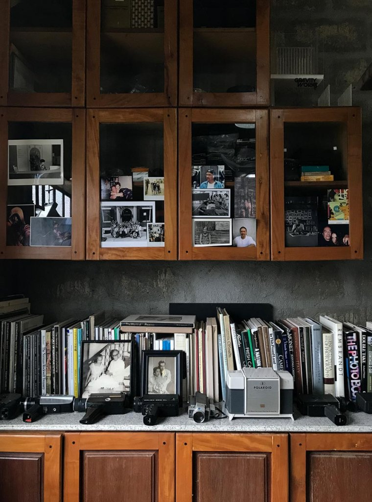 Shelves in Fotobaryo housing with a hodgepodge of memories with family and ICP students.