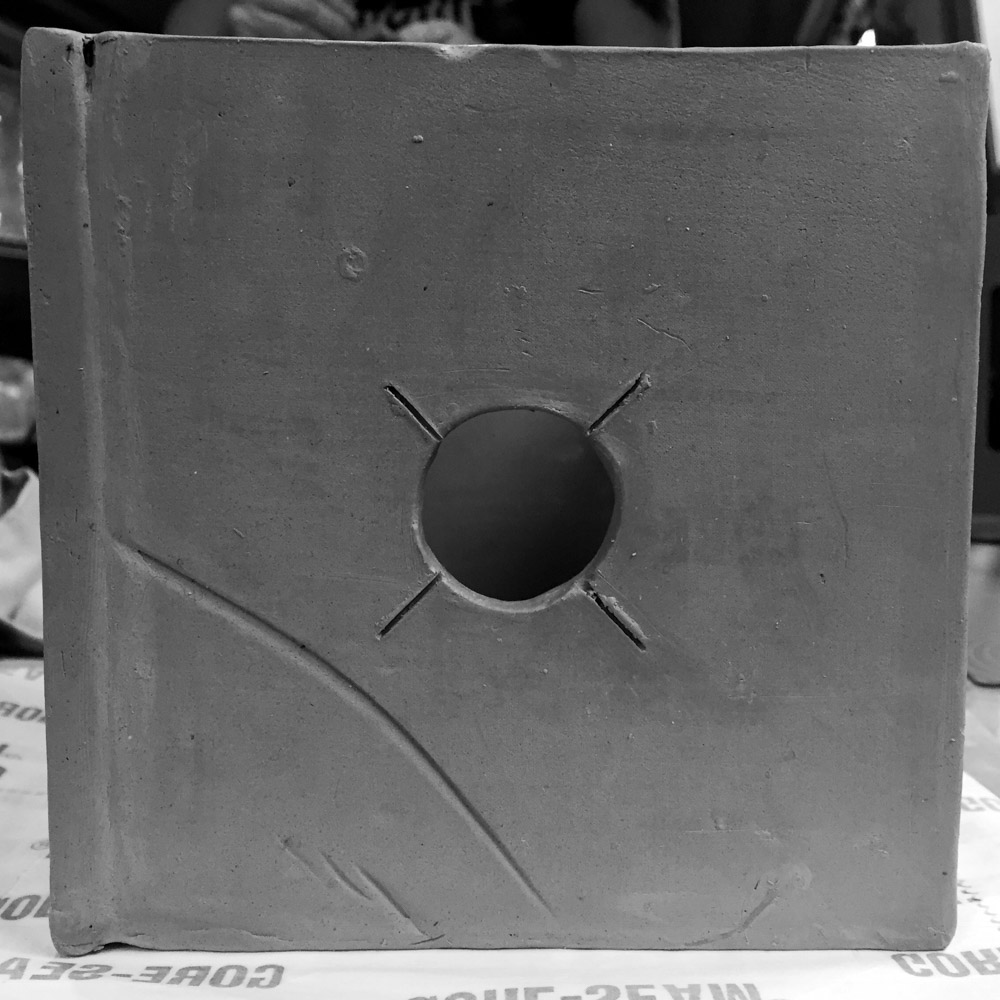 The Ceramic Pinhole Project - Main hole cut out with an X