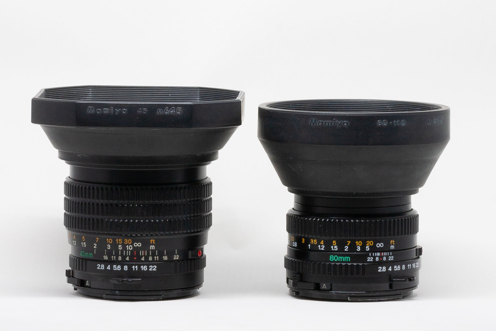 Mamiya-Sekor C 45mm f:2.8 N and Mamiya-Sekor C 80mm f:2.8 N lenses with lens hoods attached