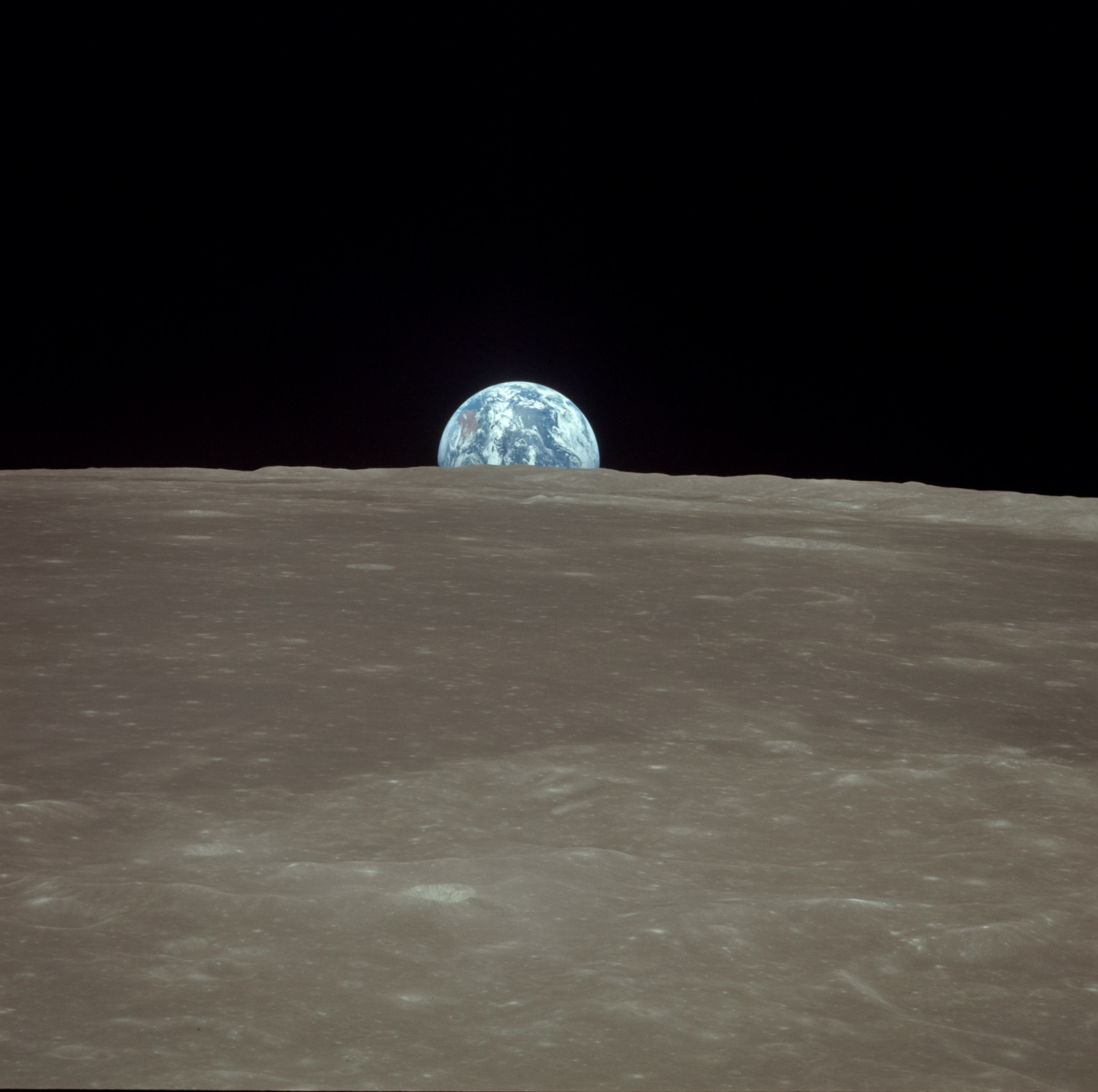 Earthrise from the Command Module Columbia. Australia is at the left, just above the lunar horizon. 20 July 1969. Credit: Neil Armstrong. NASA ID: AS11-44-6548