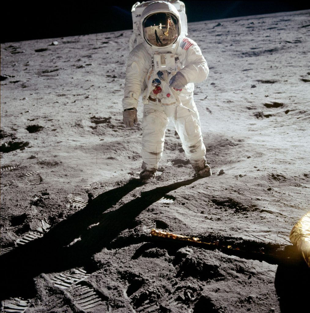 Lunar Module north-facing strut and footpad (bottom right), with Buzz Aldrin beside. Credit: Neil Armstrong, NASA ID: AS11-40-55903
