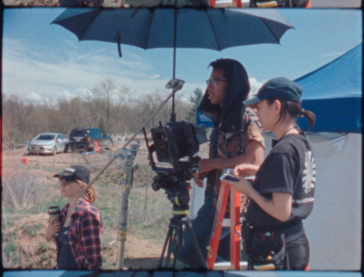 Super 8 BTS footage. That's me behind the camera, wearing the dark cloth on set of one of my shoots along with Kat Cameron, 1st AD, on the left and Sunnie Kim, 1st AC, on the right.