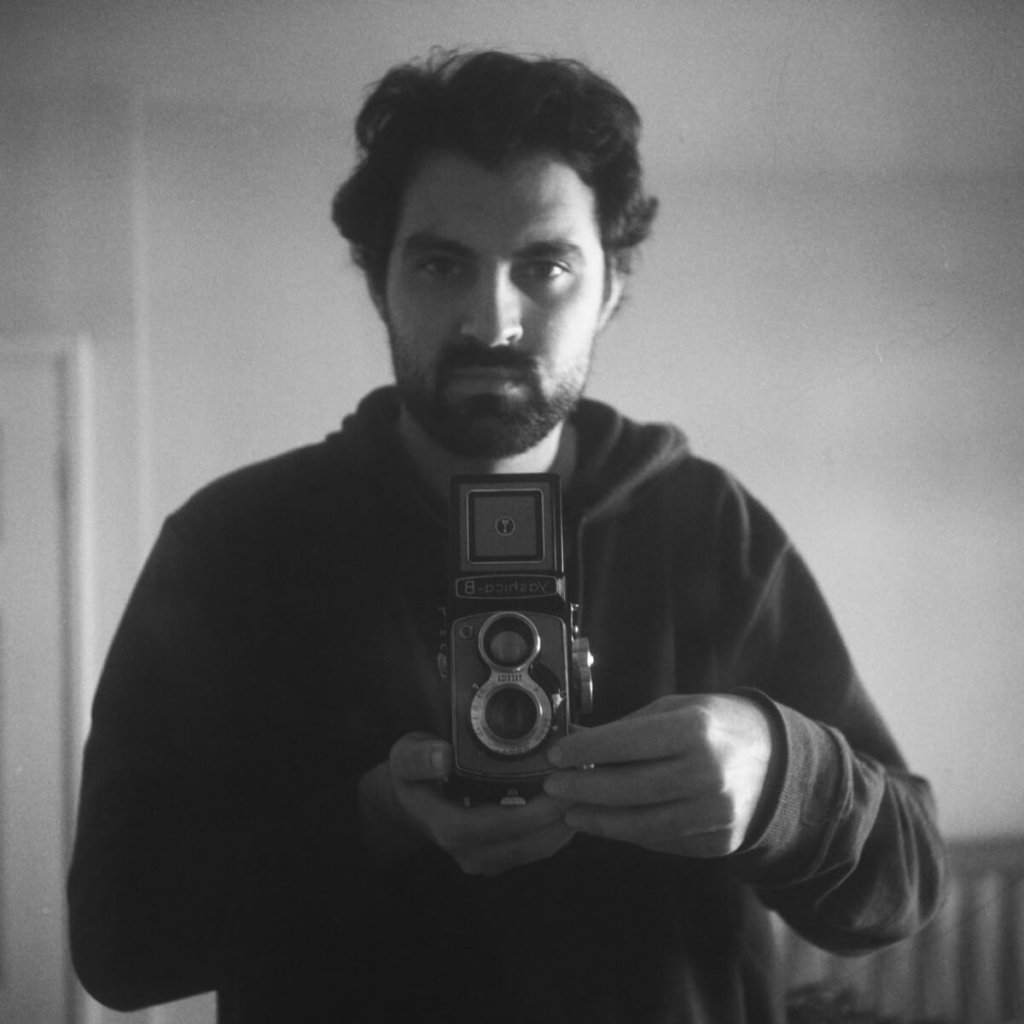 Yashica-B, Fomapan 400 Action, home Developed in Ilford HC. The classic 'selfie with vintage camera.' In this photo, the role of teenage girl is played by a scruffy bearded man