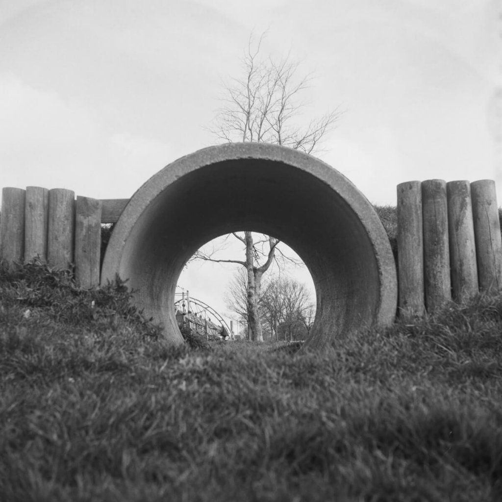 Yashica-B, ILFORD HP5 PLUS home Developed in Ilford HC. A lonely tree, seen through a concrete construction tube