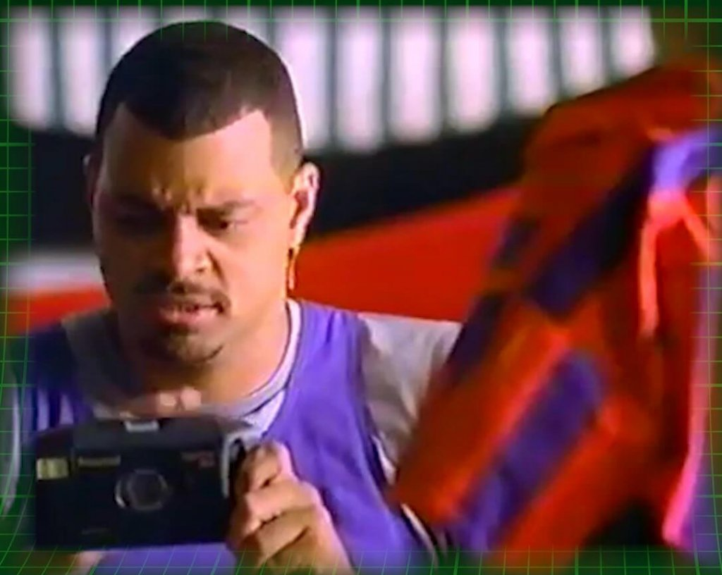 Celebs selling Polaroids - Sinbad looking confused with a Polaroid Captiva