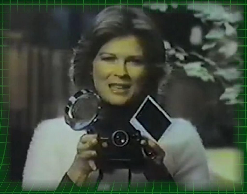 Celebs selling Polaroids - Candice Bergen with a Polaroid Pronto!