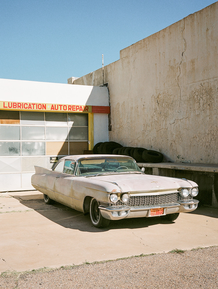 Kyle McDougall - A classic car in front of a garage