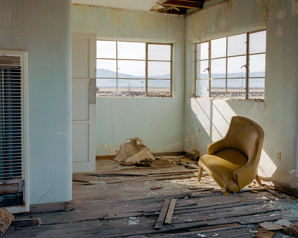 Kyle McDougall - A derelict room with a broken chair
