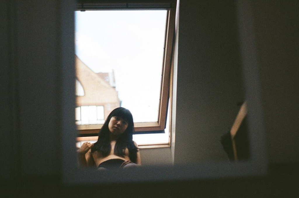 a woman looking through a window