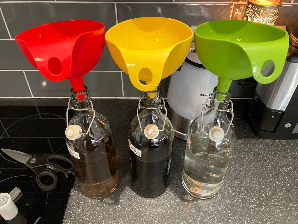 Chemical Storage - glass bottles and funnels from IKEA are great for darkrooms and very cheap / readily available