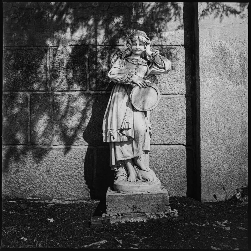 Little lady statue on the side of a farm's gate Hasselblad 500C, Carl Zeiss Distagon 50mm f/4, ILFORD FP4 PLUS