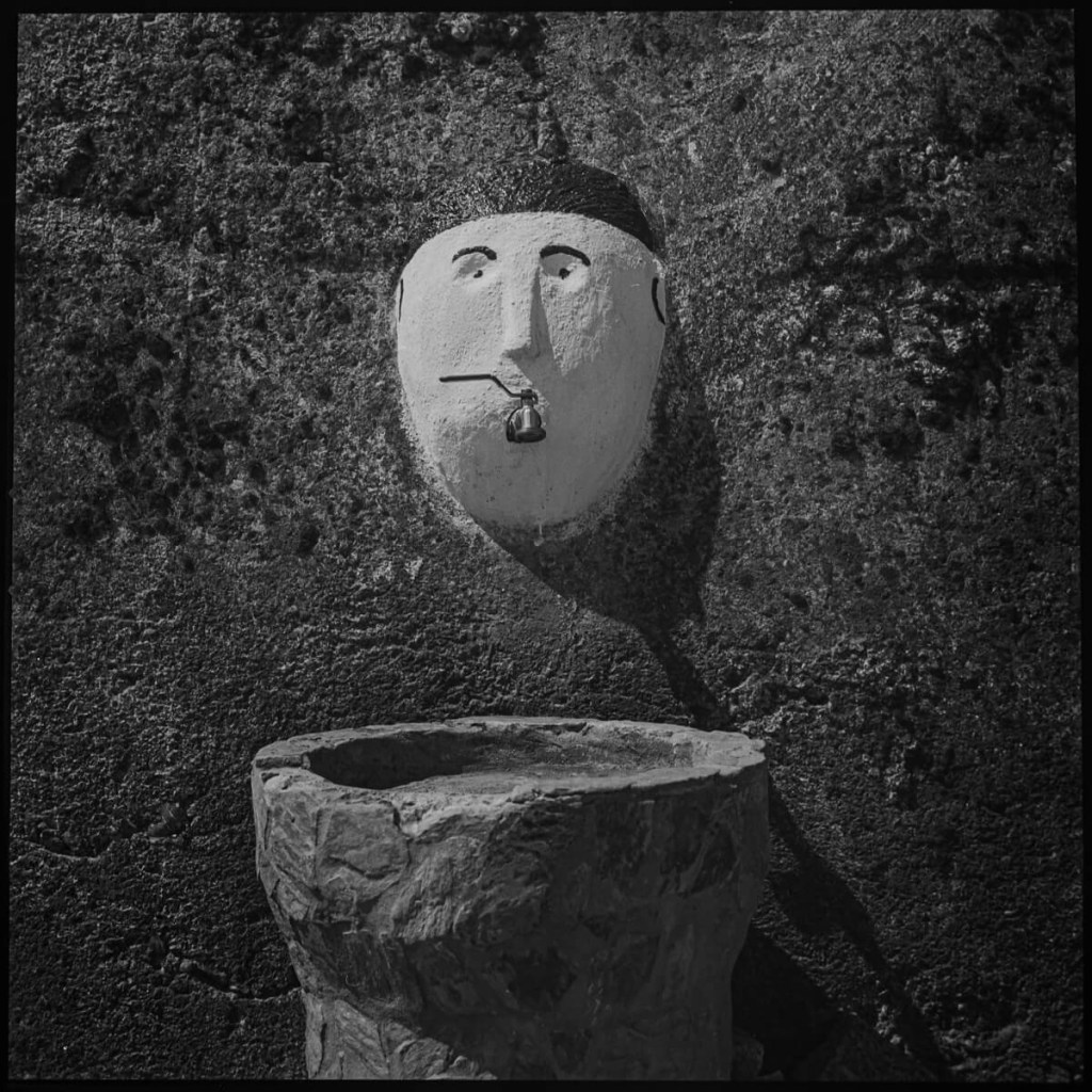 Water fountain with painted face, near Lamego Hasselblad 500C, Carl Zeiss Planar 80mm f/2.8, ILFORD FP4 PLUS