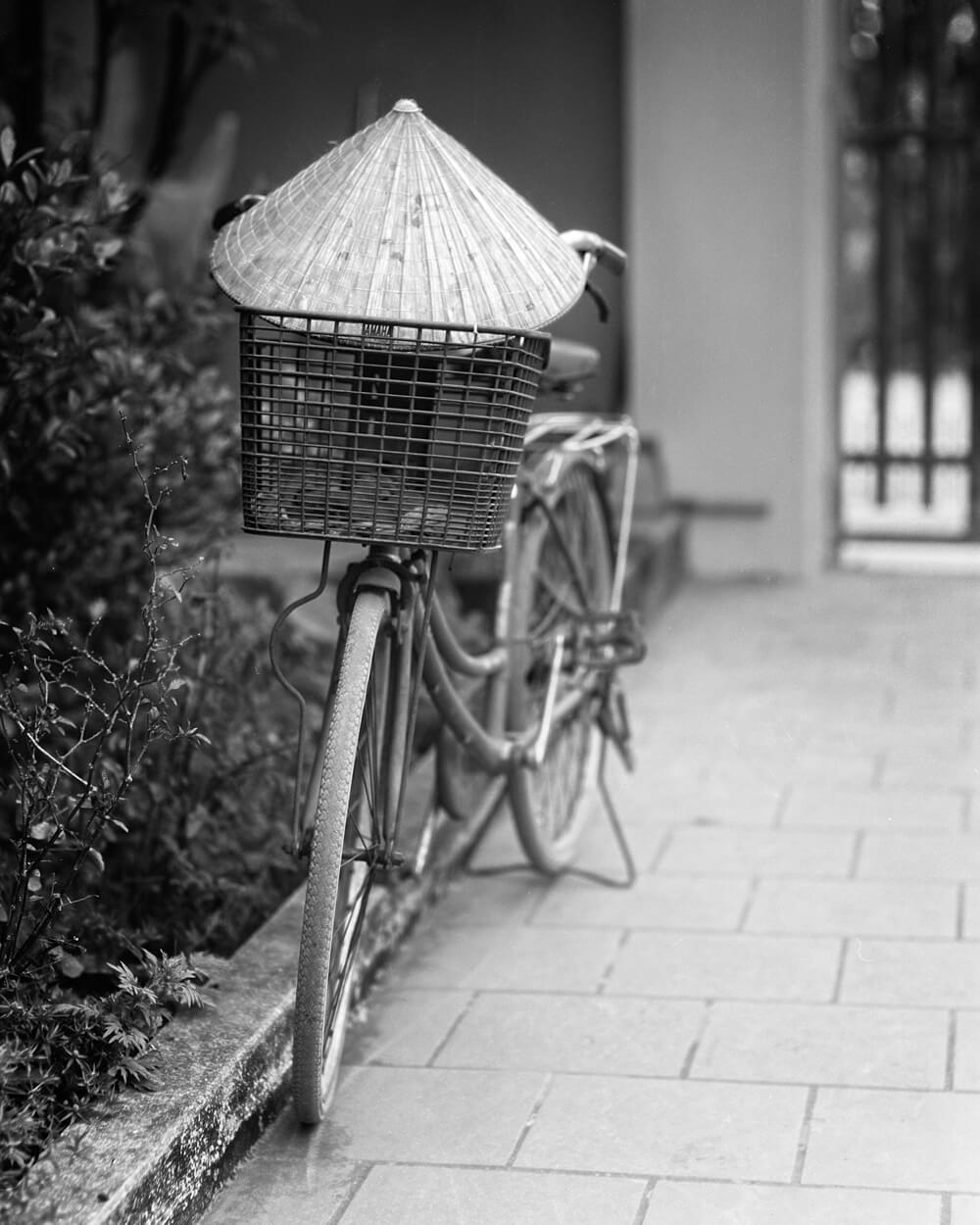 Traditional Vietnamese Hat / Bicycle - 5 Frames... Around Hai Phong, Vietnam on my 1920 Graflex RB Tele 4x5 and ILFORD HP5 PLUS (4x5 Format / EI 400 / Voigtlander Heliar 210mm f/4.5 c.1920 lens) - by Stuart Kinkade