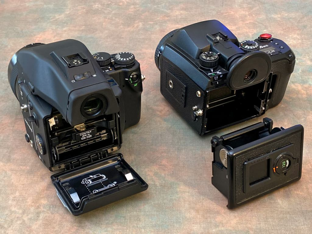 Gear Comparison - The Contax has a door to access the film insert, the Pentax film insert forms the back of the camera