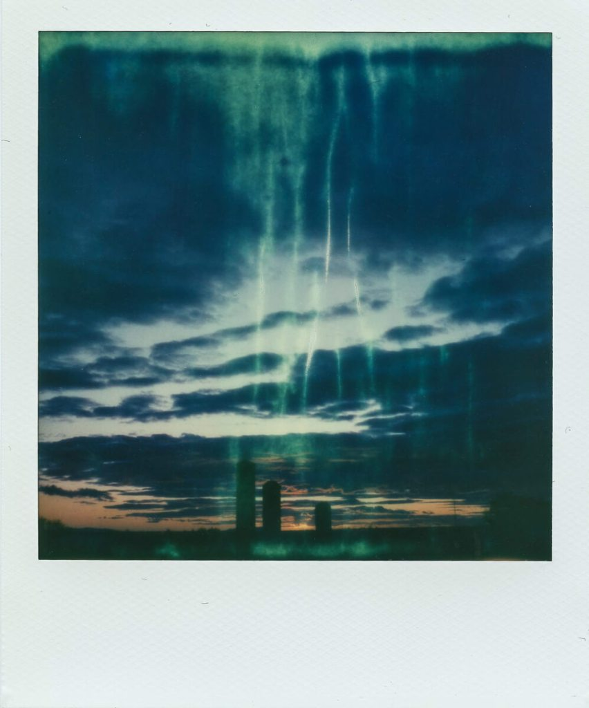 """This was actually taken on my SX-70 on a really chilly fall evening, the development was clearly affected by the cold. It's a """"happy accident,"""" but not one easily reproduced!"""