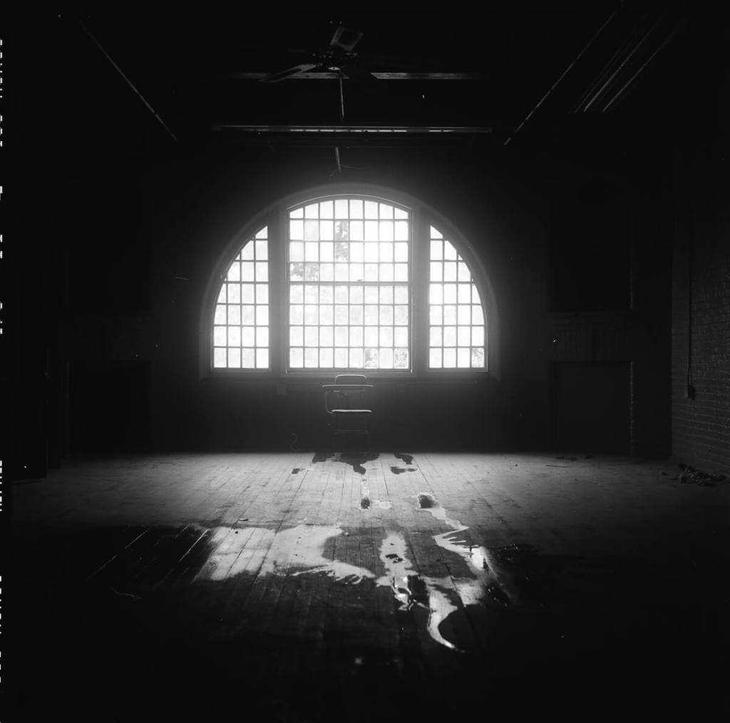 Fujifilm NEOPAN 100 ACROS - In the center of the women's mental health ward was this amazing arched window – and a leaky hot water pipe.