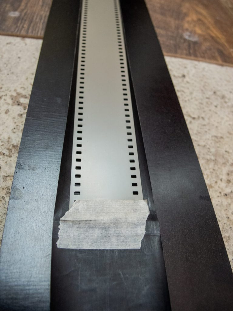 Taping the film onto the backing paper